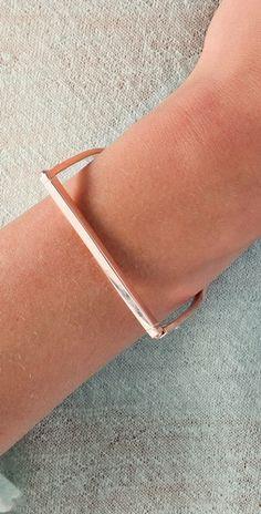 A. L. C. Handcuff bracelet