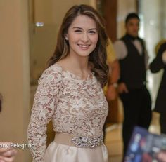 Actress Marian Rivera is wearing a nude long sleeve lace paired with a nude skirt.