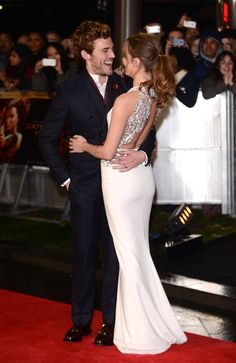 Pin for Later: Red Carpet PDA That's Way Too Cute to Handle Laura Haddock and Sam Claflin, 2013