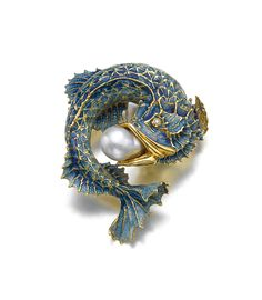 Cultured pearl, enamel and diamond brooch. Designed as a fish with a baroque cultured pearl in its mouth, the scales applied with iridescent blue enamel, the eyes inset with brilliant-cut diamonds.