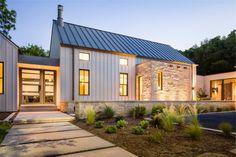 Modern Farm House with limestone, board and batten siding by Olsen Studios.