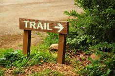 Trail sign and arrow at woods trailhead. A wooden TRAIL sign and arrow mark the , #AFFILIATE, #woods, #trailhead, #wooden, #Trail, #sign #ad