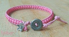 Pale pink leather and glass bead bracelet with button fastener £10.00