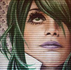 Street Art @GoogleStreetArt shared Street Art portrait on shutters by 'Rogue…