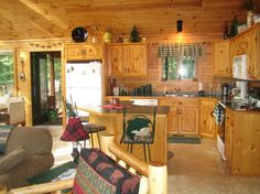 Image from http://www.copyrlght.com/images/ordinary-colors-for-small-kitchens-9-small-log-cabin-kitchen-design-ideas-1280-x-959.jpg.