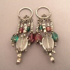 Silver, glass paste and pearl earrings from Uzbekistan. These georgious, wearable and very elegant Khanat   (under the authority of a khan) of Bukkara are very typical from this part of the world.