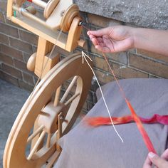 Long draw spinning on a wheel