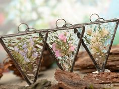http://sosuperawesome.com/post/173140123535/stained-glass-and-pressed-flower-jewelry-by