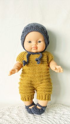 Doll Paola Reina-Gordy 34 cm (13 inches), Asian boy in a mustard blue knitted outfit.  The set includes: - Gordy doll by Paola Reina 34 cm (13 inches) Asian boy - T-shirt and diaper - Knitted jumpsuit mustard - Blue knitted cap - Blue Slippers  All clothing is easily removed, dressed, fastened. The child can dress and undress the doll himself, learning useful skills during the game. Beautiful Children, Beautiful Babies, Beautiful Dolls, Baby Doll Clothes, Baby Dolls, Blue Slippers, Baby Born, Doll Shoes, Asian Boys