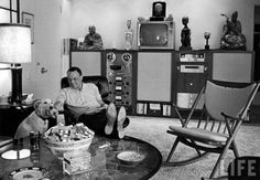 Frank Sinatra relaxing with his pet dog Ringo at home. Palm Springs, 1964.