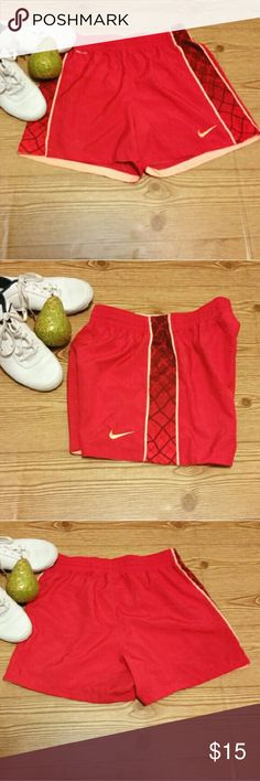 Nike Dri - Fit Running Shorts Red Orange Geo Print Pre-loved Women's Nike Dri - Fit Running Shorts in Red and Orange with a Geometric Print. Has a drawstring. Size Small. Excellent condition. Measurements : Waist -  27 inches and Length - 14 inches.  Perfect for your workout! Nike Shorts