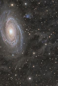 The Galaxy Wars | In the lower left corner, surrounded by blue spiral arms, it is spiral galaxy #M81's. In the upper right corner, highlighted by red gas and dust clouds, it is irregular galaxy #M82. This stunning view shows the two giant galaxies intertwined in a gravitational fight that has taken place over the last billion years. The severity of each galaxy dramatically affects the other during each pass, which lasts hundreds of millions of years.