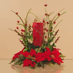 extra large  poinsettia Christmas Vase Arrangements | tall red candle large poinsettia wreath and red floral sprays make a ...