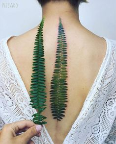Beautiful Green Fern Tattoo on the Spine