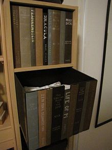 a Box With Faux Book Spines to Hide Stuff Inside Storage Box made with Book Bindings, slide it onto your shelf and it looks like a shelf of books!Storage Box made with Book Bindings, slide it onto your shelf and it looks like a shelf of books!