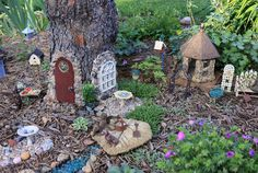 """A whole fairy village (This. Is. Gorgeous! If I put a village like this in my garden, I'd give the faeries a """"lakefront view"""" and add a cute little pond with a dock)"""
