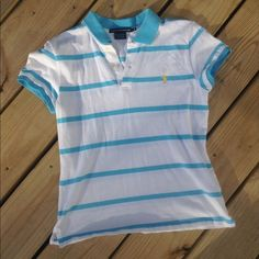 RALPH LAUREN SPORT BLUE AND WHITE STRIPED POLO Cute Ralph Lauren striped polo top. Blue and white stripes with yellow emblem. Great condition! Size medium Ralph Lauren Tops Tees - Short Sleeve