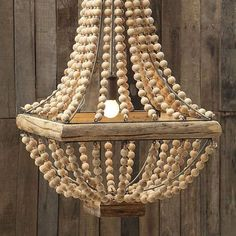 The Mauritania Chandelier takes you back to the days of great liners and exotic retreats, but the playful use of wooden beads give it a modern touch. Feature this in your own retreat for classic ship-shape style.