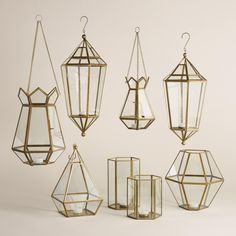 Illuminate gatherings with our contemporary, prism-like tabletop lantern, handcrafted of antique brass-finished metal and clear glass by skilled Indian artisans. It casts a warm, inviting glow with a tealight inside.