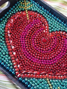 Mardi Gras Bead Art Heart by PoppyMagnolia on Etsy, $45.00. Can get customized with initials. Fun gift for a NOLA wedding.