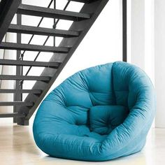 coolest chair ever! lays flat for a half circle futon type mat thing.  2 please!