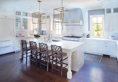 Warm up your white kitchen with dynamic design pieces