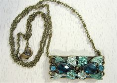 Teal blue crystal and painted bronze pendant. $22.00, via Etsy.