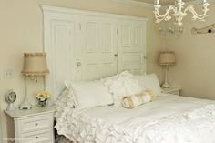 Headboard made from 3 doors.  Love the ruffled bedding (pinned from A Sort Of Fairytale)