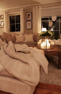 Corner sofa, knitted throw hearts, wooden floors and rug. #Love #Rustic