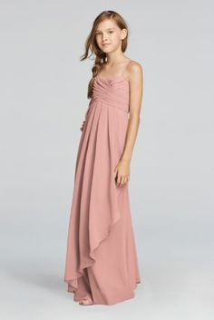 Chiffon is breezy and easy to wear, and the cascading side ruffle on this long junior bridesmaid dress makes it fun to dance in, too. Long crinkle chiffon is lightweight and allows for movement. Fully Lined. Back Zipper. Dry Clean Only. Complements perfectly with style W10840. To protect your dress, try our Non Woven Garment Bag.