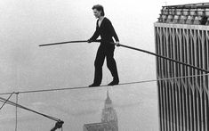collective-history: Philippe Petit, a French high wire artist, walks across a tightrope suspended between the World Trade Center's Twin Towers in New York on Aug. World Trade Center, Trade Centre, Magnum Opus, New York Movie, Today In History, Grand Format, Moment Of Silence, Crime, Philippe