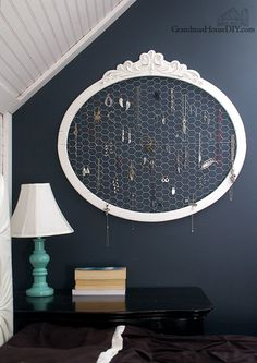 An Old Frame and Chicken Wire Upcycled Into a Jewelry Hanger!