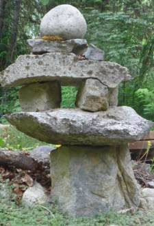 Landscape Stone Lantern - landscaping with rocks can make an incredible ambiance in a garden; whether you're gardening in a Japanese style, or more modernistic, rocks have something for every garden.