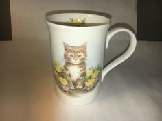A personal favorite from my Etsy shop https://www.etsy.com/listing/509312009/vintage-pretty-kitten-cat-white-floral