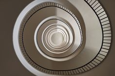 The World's Most Daring Staircases Are In This European City Photos | Architectural DigestWith its natural, shell-like quality, this stairwell is reminiscent of a Frank Lloyd Wright–designed interior.
