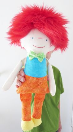 50% of the sale price will be donated to Drumm Farm, a home for kids and young adults in the Missouri foster care system. http://drummforkids.org/  The Mollie Shop has created ten handmade, one of a kind fabric Team Lu & Ed dolls!  This is Darwin! He loves to read books and always gets 100% on his tests at school! In his free time he likes to write poetry for his best bud, Daria!