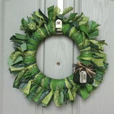 St. Patrick's Day Wreath. One wreath form + five quarter-yards of green fabric + small wooden shamrock + lots of tying = festive and cheap cuteness