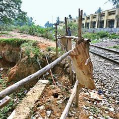 """#Bangalore #Lingarajpuram """"Even after several rounds of complaining, roads in Lingarajapuram Main Road (UNDER THE FLYOVER) have been in bad shape for years and also by the railway track. Pathetic condition of roads has been troubling residents."""" - Mervin Marshal. Click on the link to VOTE UP Mervin's complaint to get the issue resolved faster: http://bit.ly/1pzWS9v"""