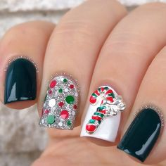 Simple Christmas nail design: These polishes reflect the colors of the Christmas & the candy cane nail charm is the perfect topper to this holiday manicure!