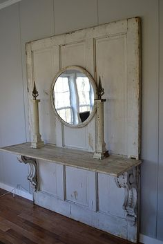 large old door, 2 corbles and a shelf make a nice sideboard.