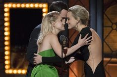 """Presenters Jim Parsons and Taylor Schilling greet American actress Annaleigh Ashford (L) as she accepts the award for Best Performance by an Actress in a Featured Role in a Play for """"You Can't Take It with You"""". REUTERS/Lucas Jackson"""