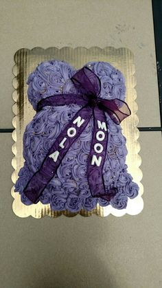 Purple belly baby shower cake with rosettes