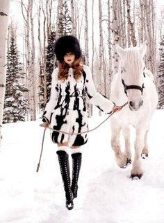 White horse & black bridal/hoofs match white birch & black chevrons match her white &black outfit.