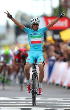 SHEFFIELD, ENGLAND - JULY 06: Vincenzo Nibali of Italy and ProTeam Astana crosses the line to win the second stage of the 2014 Tour de France, a 201km stage between York and Sheffield, on July 6, 2014 in Sheffield, England. (Photo by Bryn Lennon/Getty Images)
