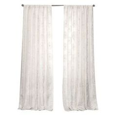 "White curtain with a ribbon-embroidered floral motif.   Product: Curtain panelConstruction Material: 100% PolyesterColor: WhiteFeatures:  Ribbon embroidery3"" Rod pocket Dimensions: 84"" H x 50"" WNote: No lining. Image depicts two panels but these are sold individually.Cleaning and Care: Dry clean"