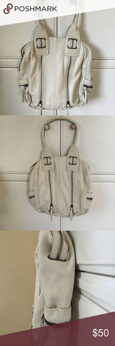 TANO Leather Hobo Bag TANO Leather Hobo Bag in a yummy soft cream color.  The feel of this bag is unreal.  It holds so much and has plenty of great pockets to choose from.  In prisitne condition Tano Bags