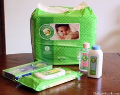 Comforts for Baby powder, baby oil, baby wipes, baby diapers, and cotton swabs
