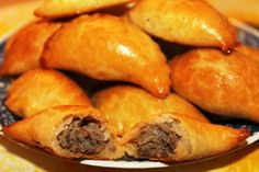 Piroshki - These little meat turnovers are baked not fried, use tea plate to cut out dough Polish Recipes, Meat Recipes, Cooking Recipes, Cooking Tips, Ukrainian Recipes, Russian Recipes, Lithuanian Recipes, Russian Foods, Croatian Recipes
