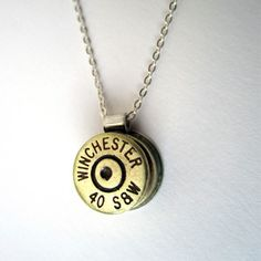 """bullet necklace - two bullet casings with a piece in the middle as the """"loop.""""  Easy to make (thanks to my husband!) and I LOVE it!"""