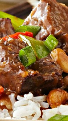 Slow-Cooker Asian-Style Beef Recipe ~ chunks of beef get meltingly tender in the slow cooker, simmered in an Asian-inspired blend of toasted sesame dressing, garlic and teriyaki sauce